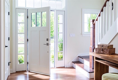 white Pella door set in a modern farmhouse style with lots of natural light framed by accent windows
